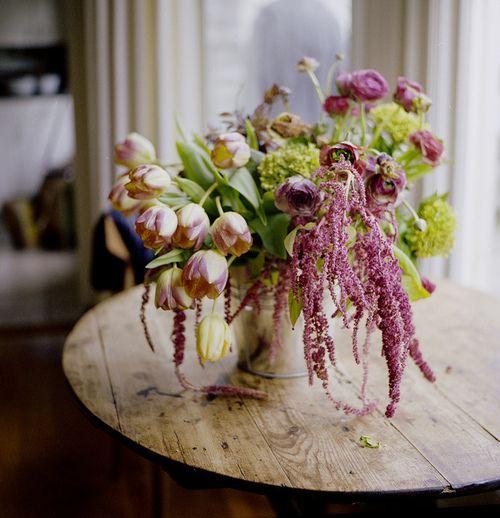 Drooping tulip and ranunculus arrangement