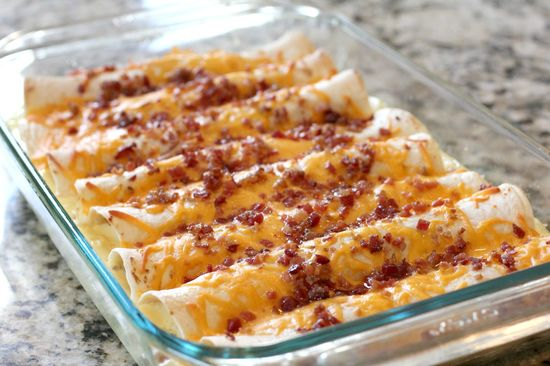 Breakfast Enchiladas Filled with sausage, egg, cheese, and bacon...delicious and hearty breakfast!