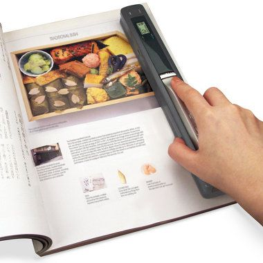 Portable Scanner... Carry this in your purse. While visiting family and you see pics you don't have dig out the scanner..
