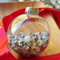 Perfect DIY Christmas ornament. Use old book pages or magazine articles and fold into paper stars for Christmas.