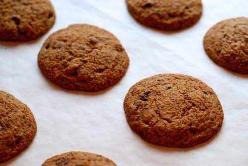 Grain-free cookies made with almond flour, coconut oil, chocolate chips, eggs, maple syrup, baking soda, and vanilla extract.