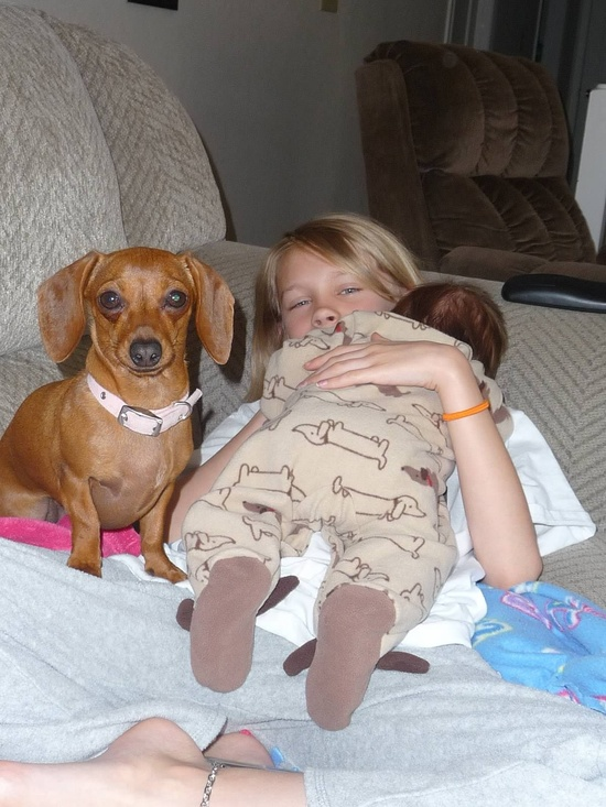 Ginger modeling next to Erynn's Doxie jammies! This was the first baby outfit I bought when I was pregnant!