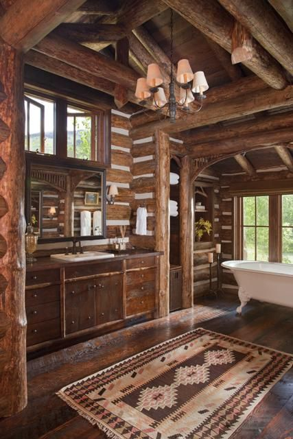 Beautiful and rustic log home bathroom with an abundance of warm-toned wood  (via 360 Ranch - Main Lodge - Architect Portfolio