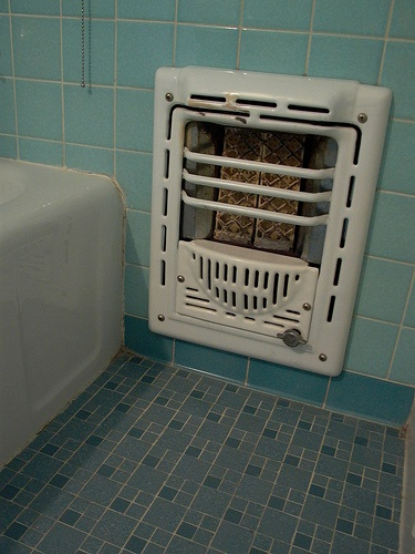 Vintage bathroom tile and heater... had them in our house... still do, and they still work!