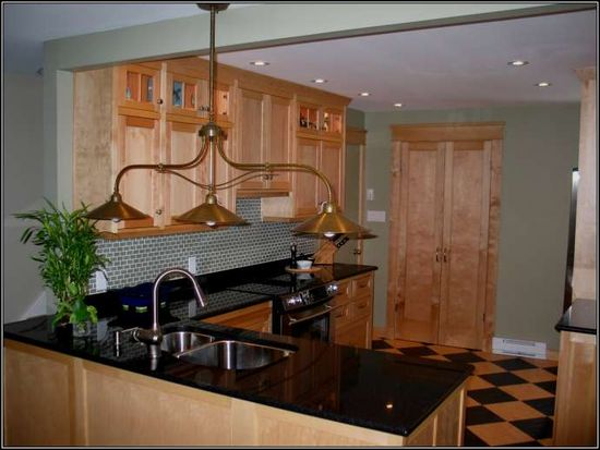 Yellow birch cabinets with black granite counter-tops and what looks like green paint and green-ish tile backsplash. Hmmm...