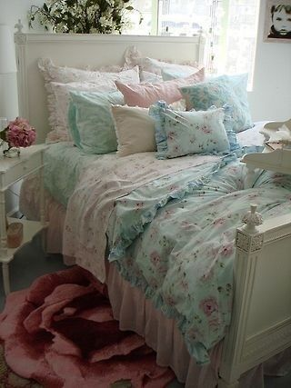 Shabby chic bedroom - I like the layers - not the rug.