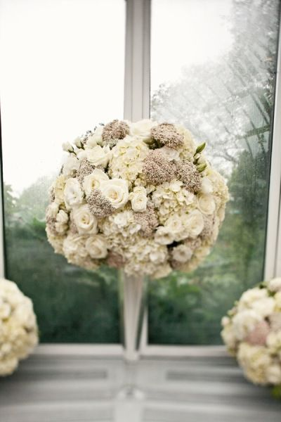 Such a very lovely combination of flowers used in this centerpiece.