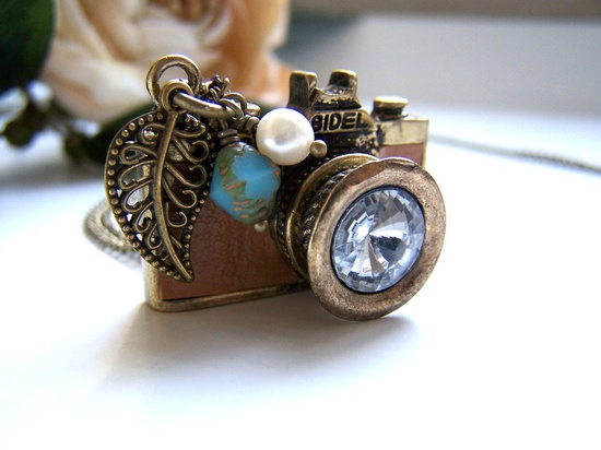 the tan leather camera necklace.. $23.00, via Etsy.