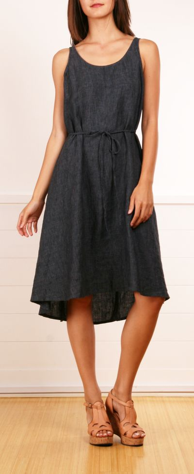 A simple denim dress with a short to long hemline and a thin attached waist belt