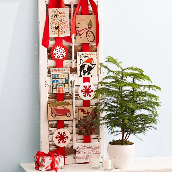 Put Christmas cards on display using an antique shutter and ribbon. See more easy holiday projects: www.bhg.com/...