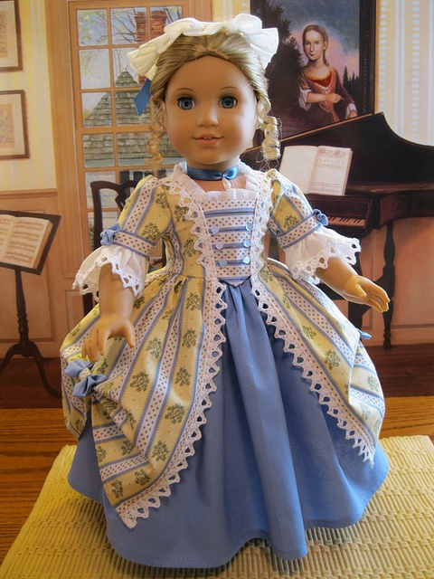 Yellow and blue colonial dress.