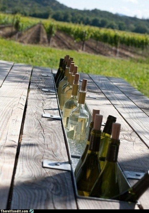 Swap the middle board of a picnic table for a rain gutter filled with ice and drinks.