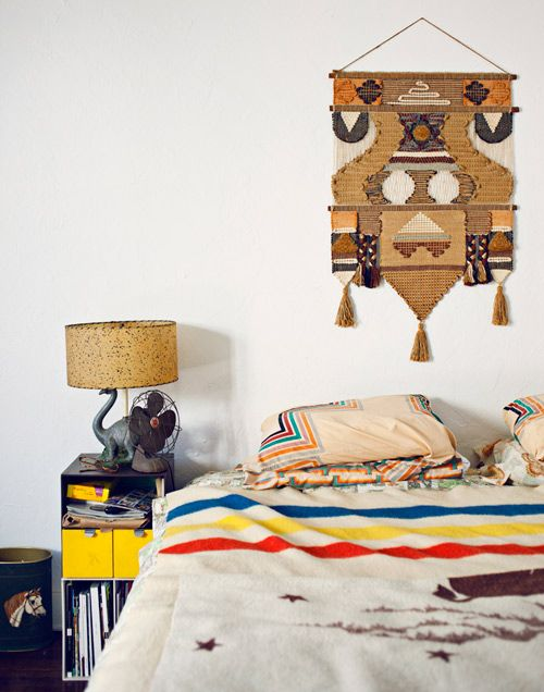 The beautiful wall hanging in the Eagle Rock, California, bedroom of Julie Galdo and Cody Cloud is only slightly eclipsed by the dinosaur bedside lamp.
