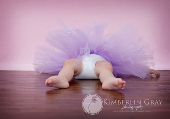 Baby girl tutu photo tipped over. Photography with kids. Funny pic.