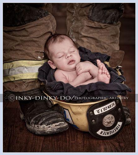 Newborn firefighter pose