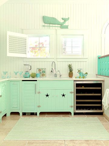 Mint green kitchen with an adorable whale decoration