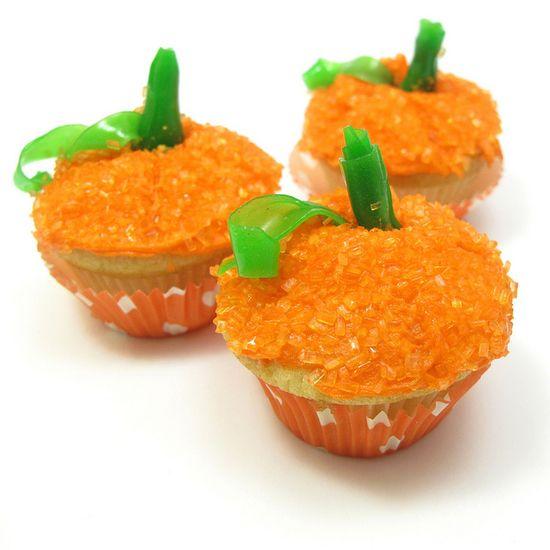 Sweetly adorable little Mini Halloween Pumpkin Cupcakes. #orange #pumpkin #Halloween #food #cupcakes #cake #dessert #baking
