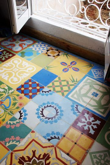 love this patchwork tile floor. Handmade tiles can be colour coordinated and customized re. shape, texture, pattern, etc. by ceramic design studios