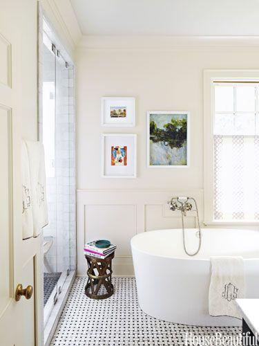 Pebbled floor. Design: Barrie Benson. housebeautiful.com. #bathrooms