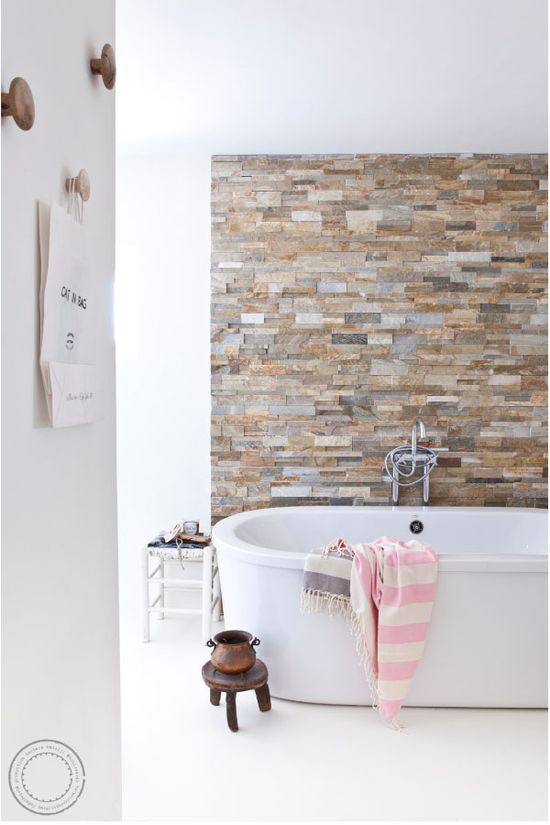 Master en-suite bathroom - love the stone wall and white floors and tub