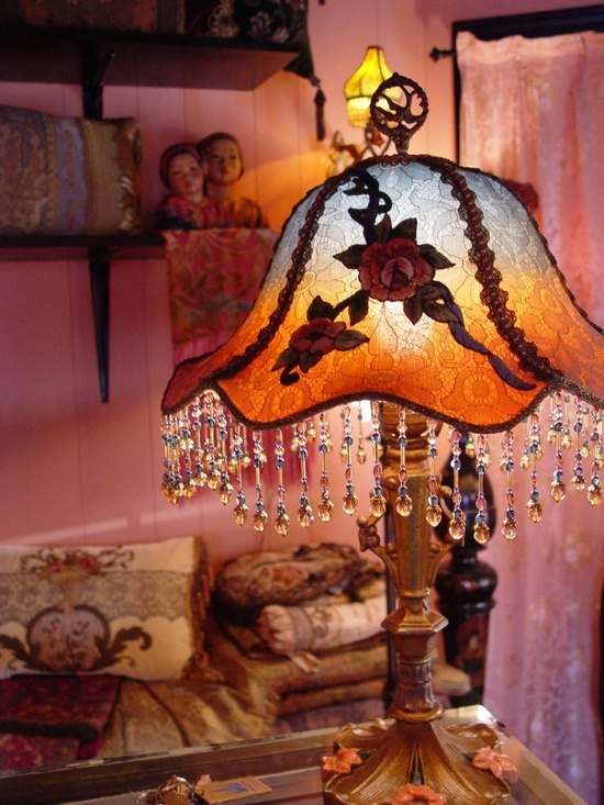 Antique 1920s Boudoir Beaded table lamp with cast iron base.  via Etsy.