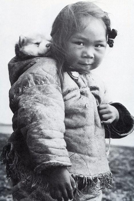 Inuit girl and her husky.