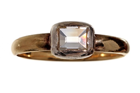 Early Georgian table cut diamond ring. Bright table cut diamond (.61 cts) in 18k gold and silver setting.  Circa 1750-1800.  This ring was originally closed back and foiled. The back has been opened and the foiling removed, making the ring more wearable. [Thus destroying it's identity and authenticity as a Georgian ring. Swift move, there. Now you can't prove its age.]