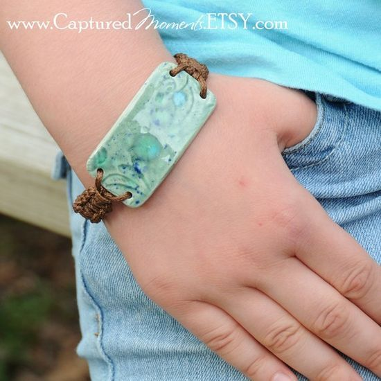 Cool handmade pottery bracelet--could be made out of glass!! Just make a barrete on the cuff bracelet mold. Could make more than just 1 at a