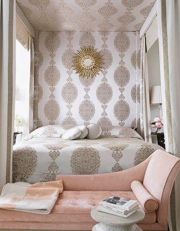 Pretty block print bedroom. Gold, pink. Hermes throw.