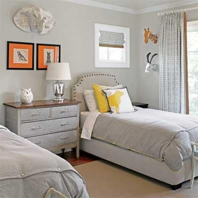 Pale gray and white form a serene backdrop for a whimsical mix of flea-market and Internet finds in this guest room.
