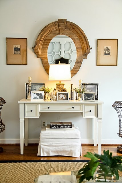 love this--mirror, table full of photos...