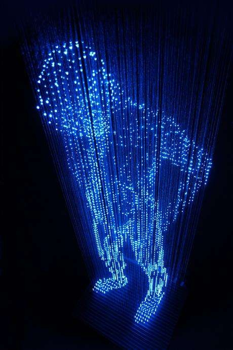 Man with No Shadows by Makoto Tojiki: Consruction of a life-sized man made of LED lights which hang on threads from the ceiling.