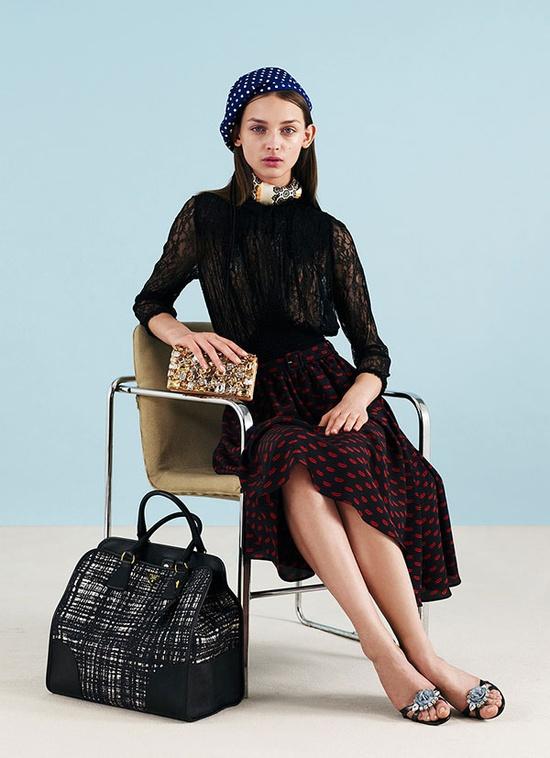 Prada wearing modern furniture