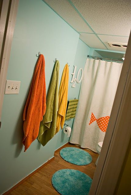 Cute kid friendly bathroom. Love the rugs.
