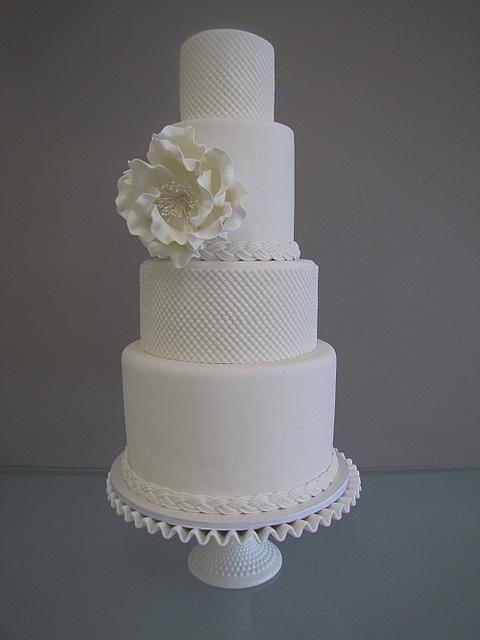 white hobnail wedding cake with sugar peony