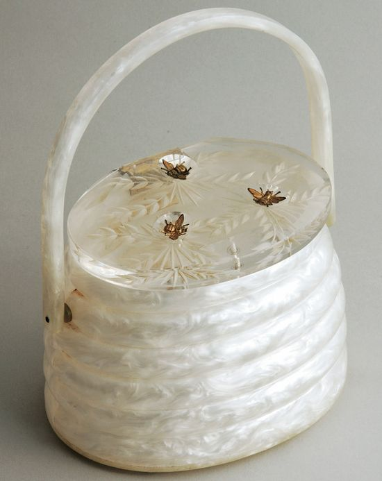 "A ""Beehive"" purse, made by Llewellyn in the 1950s, from Judith Miller's personal collection. With its three brass bees, this Lucite handbag is one of most coveted bags Llewellyn ever made.-gorgeous"
