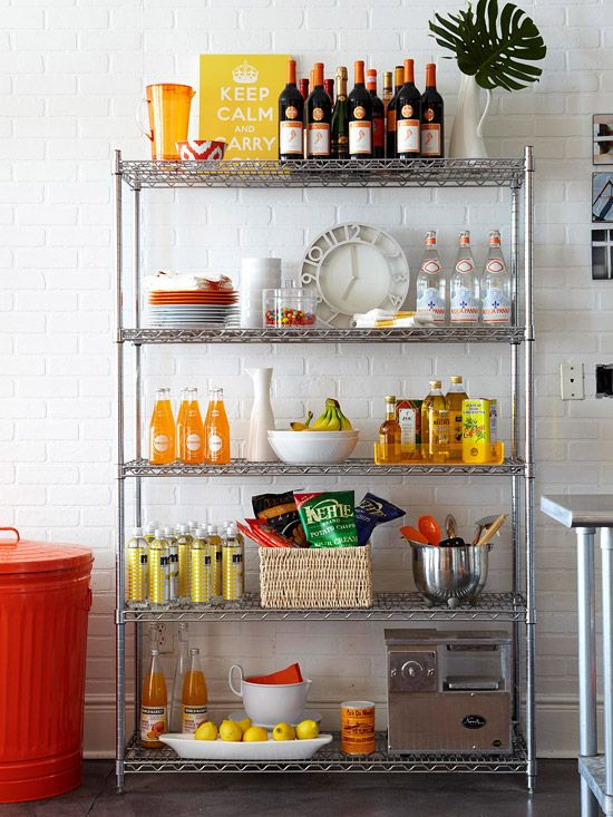 Embrace Open Storage  Employ an industrial metal shelving unit as extra kitchen storage if your apartment's kitchen storage options are less than generous. The cool finish of this unit recalls metal touches that are standard in pro kitchens. Use baskets to corral kitchen staples, and incorporate a few decorative touches to keep it fun.