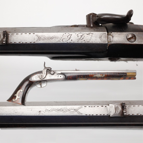 JOHN DOMER PENNSYLVANIA/KENTUCKY PERCUSSION PISTOL- Born in 1796, Domer was a gunsmith in Penn. & remained active according to the Federal censuses for 1850, 1860, 1870, & 1880.  While the number of firearms he made is unknown, here at the museum is one of his percussion pistols.  The light metal chasing on the barrel & his silver inlays on the stock help embellish an otherwise plain percussion pistol.  Domer's elegant pistol offers insight into handmade civilian handguns of that era.