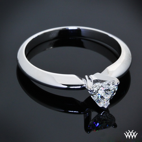 tiffany style Solitaire Engagement Ring is set in 14k White Gold and has been modified to hold a 0.40ct Heart Cut Diamond.
