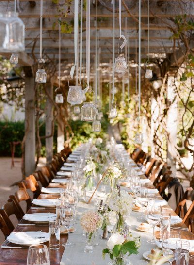 long wood tables, hanging lights