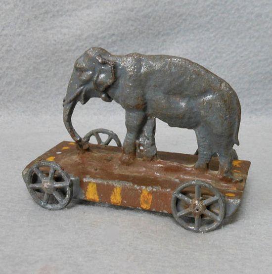 Antique Victorian Era Metal Elephant Penny Pull Toy #animals, #elephants, #pinsland, apps.facebook.com...