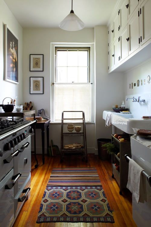 A simple kitchen with interesting details (like that giant Simon & Garfunkel poster).