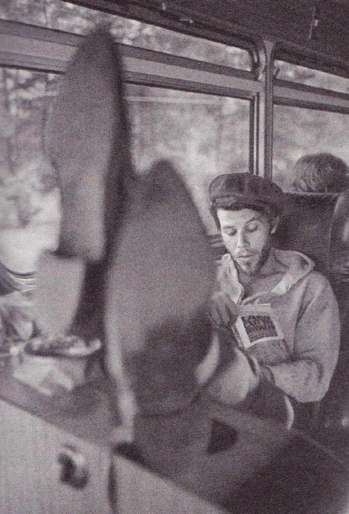Tom Waits on a tour bus reading 'Last Exit to Brooklyn', 1975