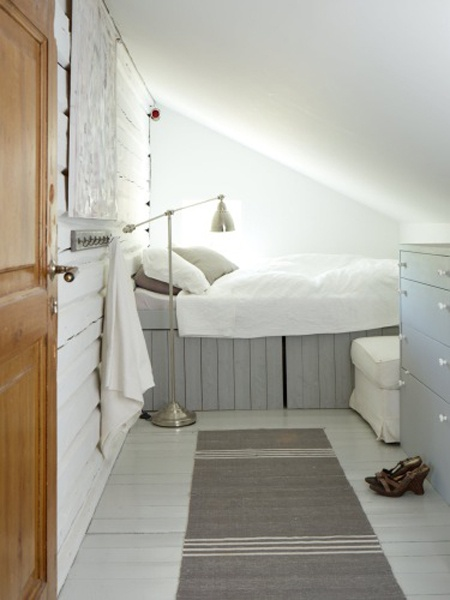 Cosy cottage attic guest bedroom in Nordic gray and white...