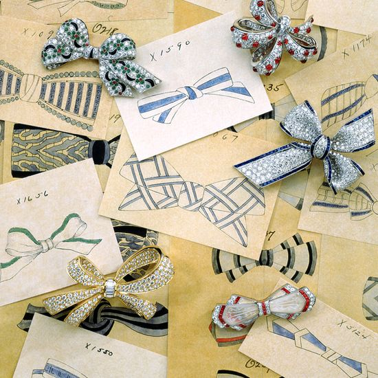 Tiffany bow brooches of diamonds on a background of drawings from the 1920s.