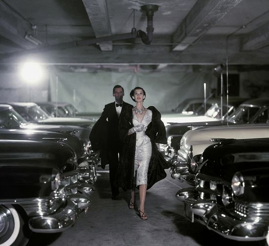 Perhaps it's his bow tie and the fact that they almost appear to be fleeing from something - or someone - but there is a definite Bond vibe to this endlessly elegant 1950s image. #vintage #1950s #evening #dress #model #couple #cars #fashion