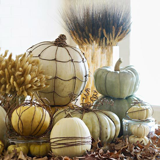 Instead of carving #pumpkins, wrap them in grapevines for a fresh look. More seasonal ideas:  www.bhg.com/...