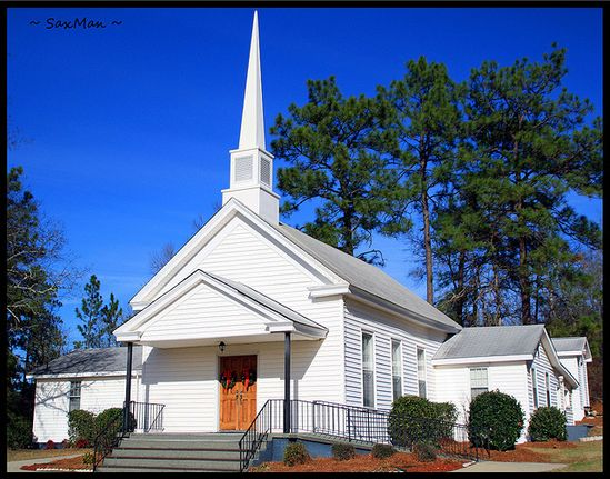 The Chime Bell Church. A small country church framed by tall Carolina pines. This church was built in 1902 and is a beautiful,