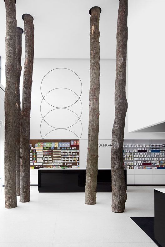 Okinaha Store in Brussels by Belgium multi-disciplinary branding office Coast together with As-Built Architects. I like how the tree trunks add materiality to the otherwise abstract white space.
