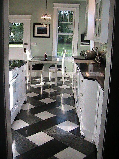 black counter white cabinet kitchen